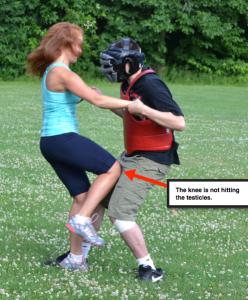 Girl kicks guy in the balls