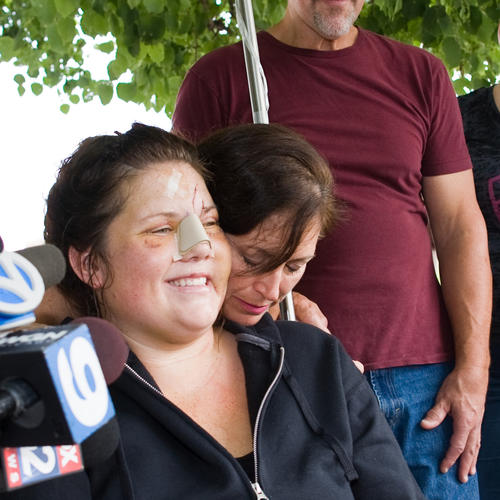 Brave Melissa Shuster gets a hug from her mom upon leaving the hospital.