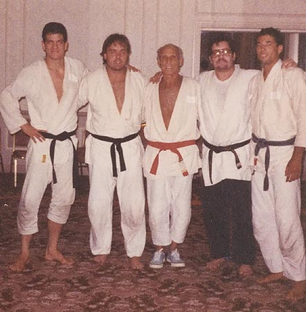 Carl (second from left) in 1989 with his arms on Helio and Royce Gracie. Carl recalled the Gracie's were extremely generous, hard working and kind. He had a great deal of respect for them.