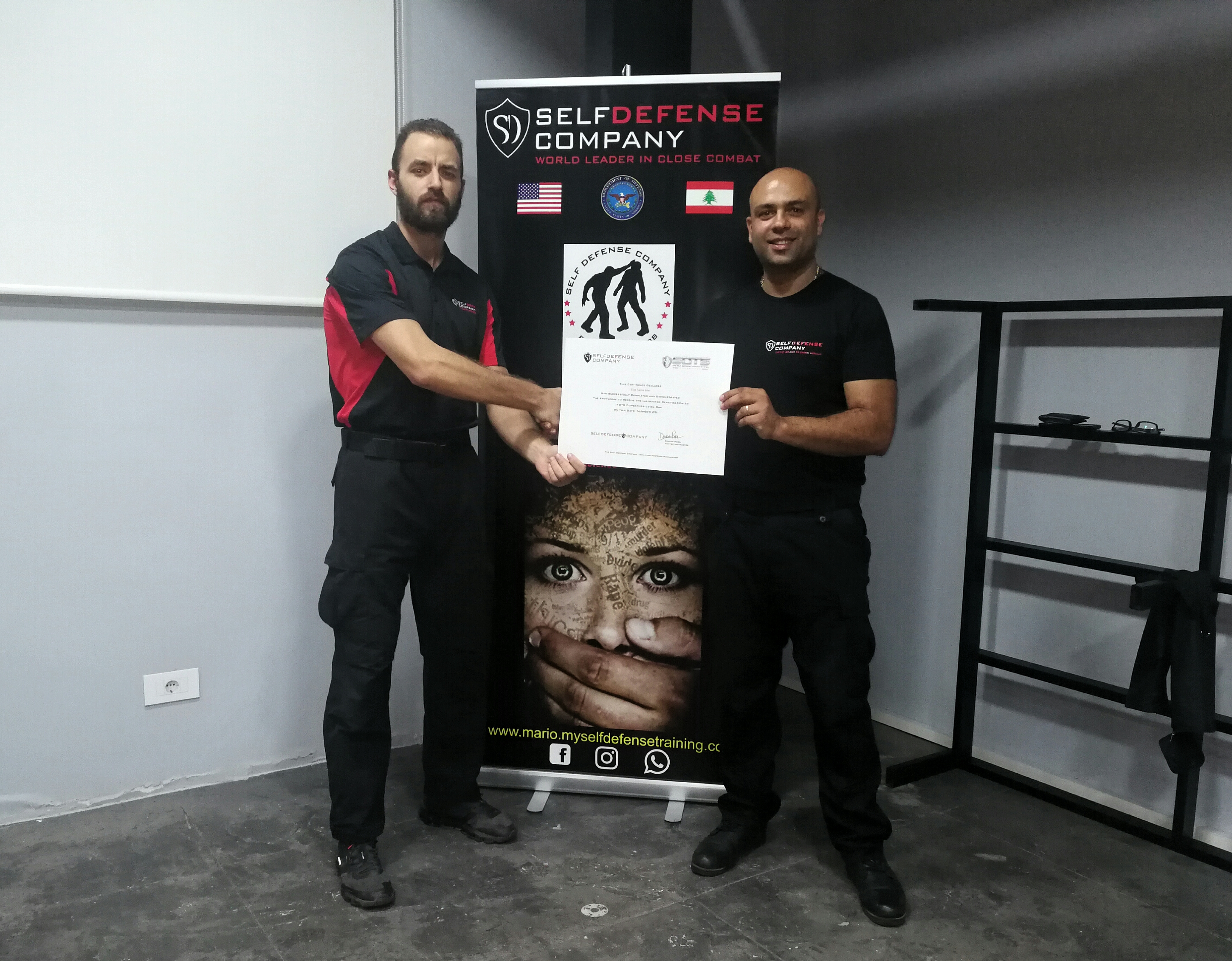 Instructor Karam awards another student his certification