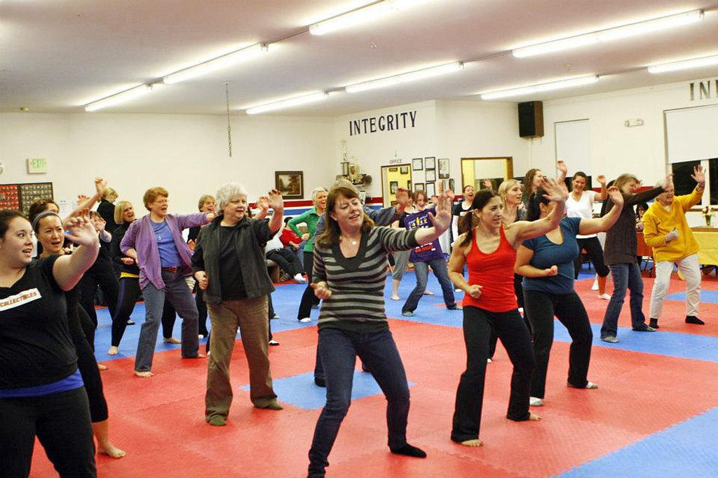 women learning self-defense
